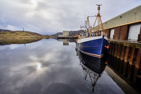 Boat in fishing harbour