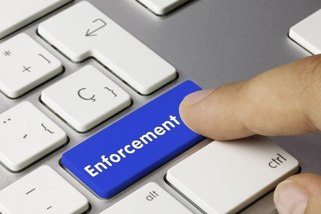Enforcement word on key board, finger pressing button photo credit Adobe Stock by momius