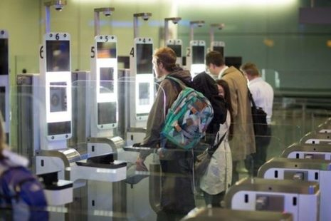 People using eGates at an airport