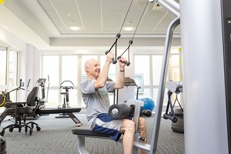 Man doing strength exercises in gym