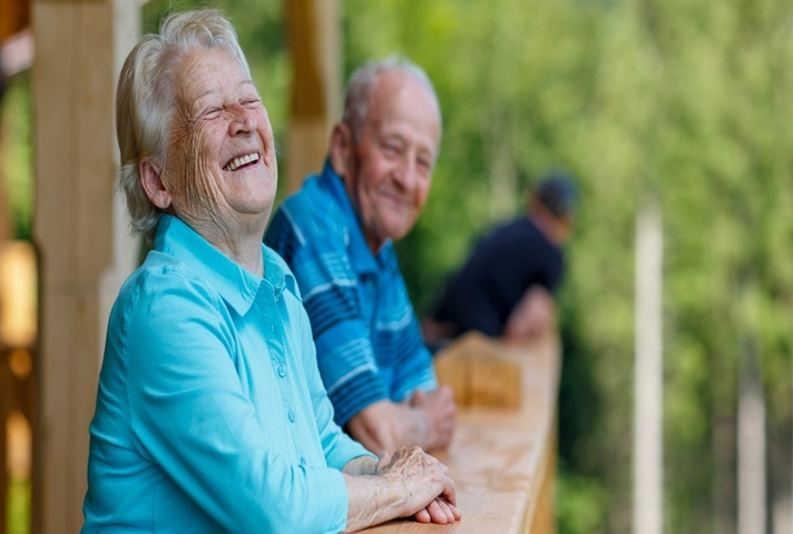 older man and woman having a laugh