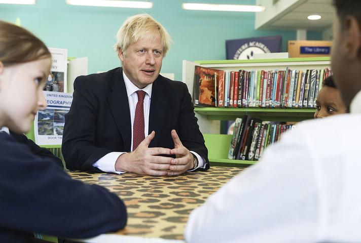 Prime Minister Boris Johnson speaking to pupils in school library