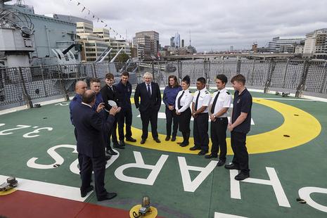 Prime Minister Boris Johnson visits the Pharos NLV ship on the Thames in London
