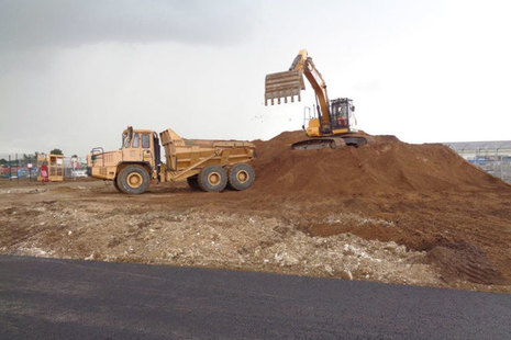 Image of RAF Lakenheath and a digger working at the construction site.