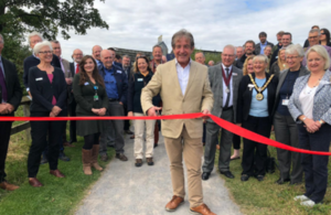 Natural England chair, Tony Juniper, cutting ribbon to open new path