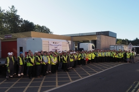 The staff at Wylfa gather in front of the final flask of spent fuel