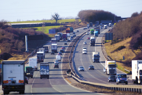 Image of several lorries travelling on a motorway