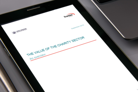 A tablet computer displaying the front cover of our paper 'The value of charity'.