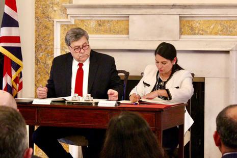 Home Secretary Priti Patel signing the UK-US Data Access Agreement