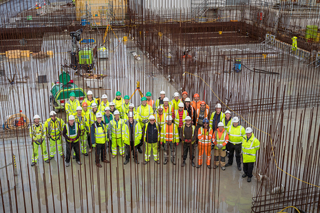 The team and senior management are photographed before the final concrete pour takes place