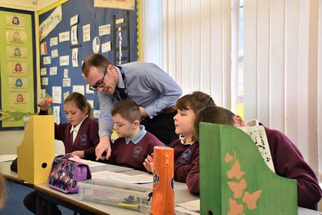 Teacher with KS2 pupils