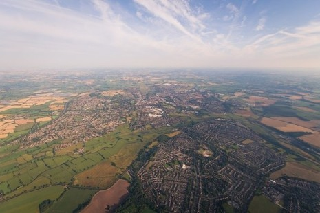 Aerial photo of a town surrounded by farmland