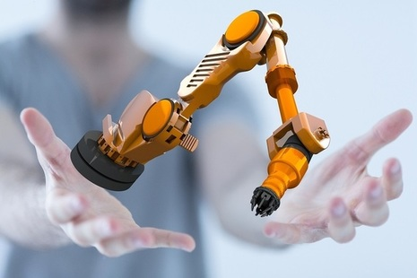 hands reaching out to touch a robot in mid air