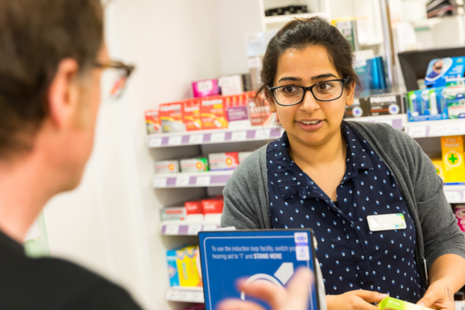 Pharmacist speaking to patient in hospital