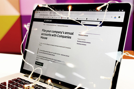 Laptop screen showing the file your company accounts GOV.UK page.