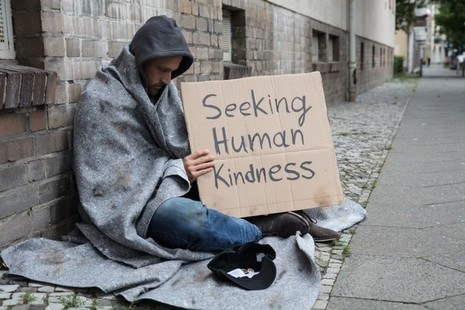 Man begging on the street - looking for human kindness