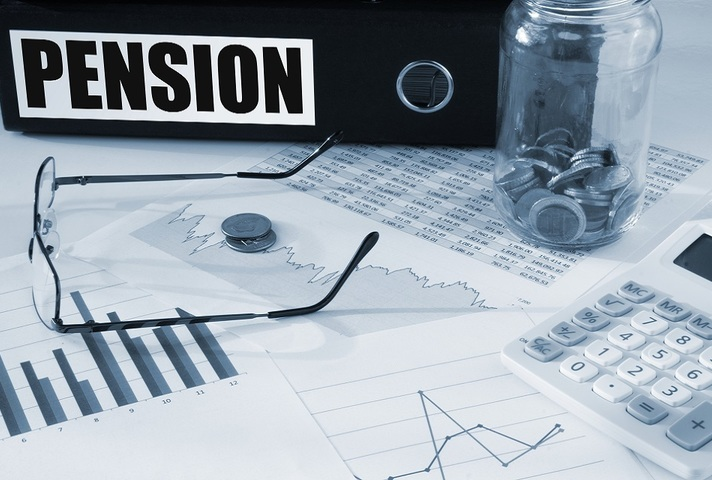 Pensions file with glasses and charts