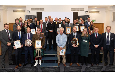 Sanctuary Award winners celebrate at awards ceremony (Crown Copyright, MOD 2019). A picture of winners holding awards.
