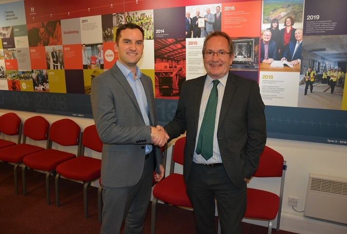 LLWR's Jonathan Evans and Steve Beattie, from Graham, shake hands over the new contract.