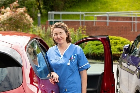 Nurse in a hospital car park