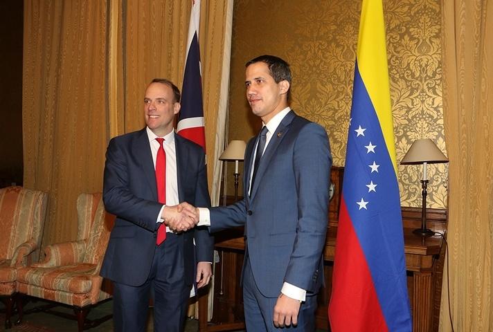 Foreign Secretary Dominic Raab shaking hands with Venezuelan interim-President Juan Guaidó