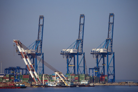 View of cranes and containers at a port