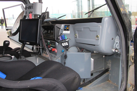 Interior view of prototype self-driving car showing dashboard systems