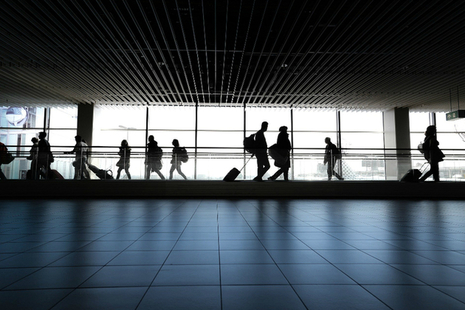 people walking along inside an airport