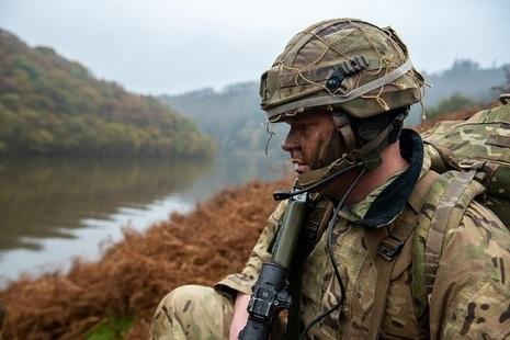 Soldier looking across a wet gap