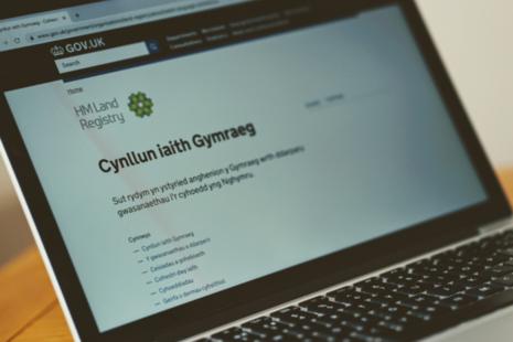 A laptop displaying HM Land Registry's Welsh language scheme.