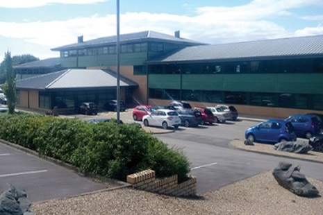 Outside the new office at Lillyhall with the carpark in front