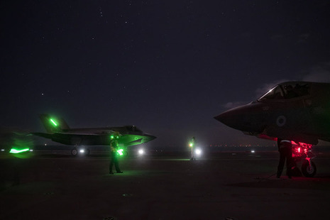 F35 Lightning jets on deck at sunset. Crown Copyright