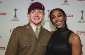 Pte Fin Doherty, who won the Inspiring Others award, stands with Alexandra Burke on the red carpet