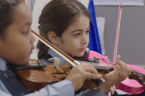 girls playing the violin