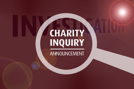 A magnifying glass with the words 'Charity inquiry announcement'.