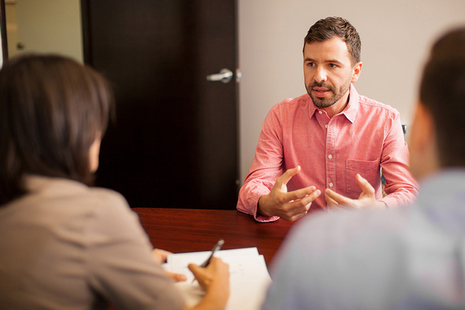 Man being interviewed in an office - Read our latest blog on working as an Examiner in the insolvency Service