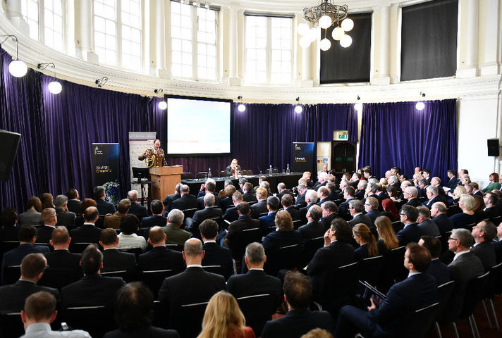 Picture of the Inaugural Strategic Command RUSI Conference with a military commander speaking at a podium in front of a seated audience.