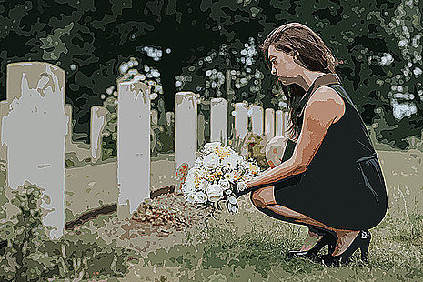 Young woman kneeling at the grave of a service person
