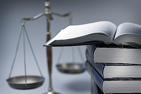 Scales of justice and legal papers