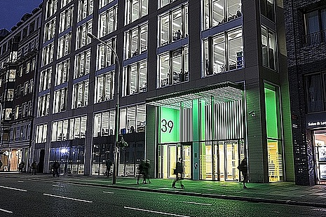 The Department of Health and Social Care viewed from the street, lit up green