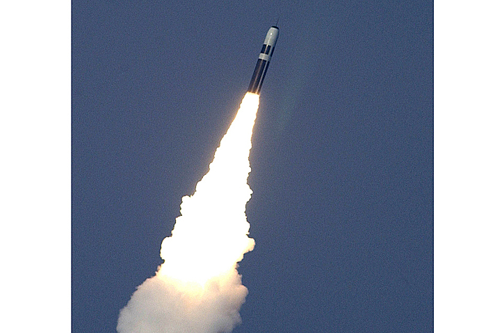 A Trident II D5 missile breaking the surface, having been fired from HMS Vanguard.