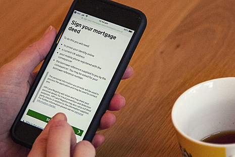 A mobile phone displaying HM Land Registry's digital mortgage service