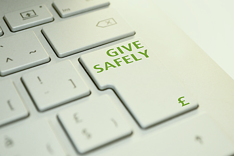 A keyboard with the words 'give safely' on the enter key.