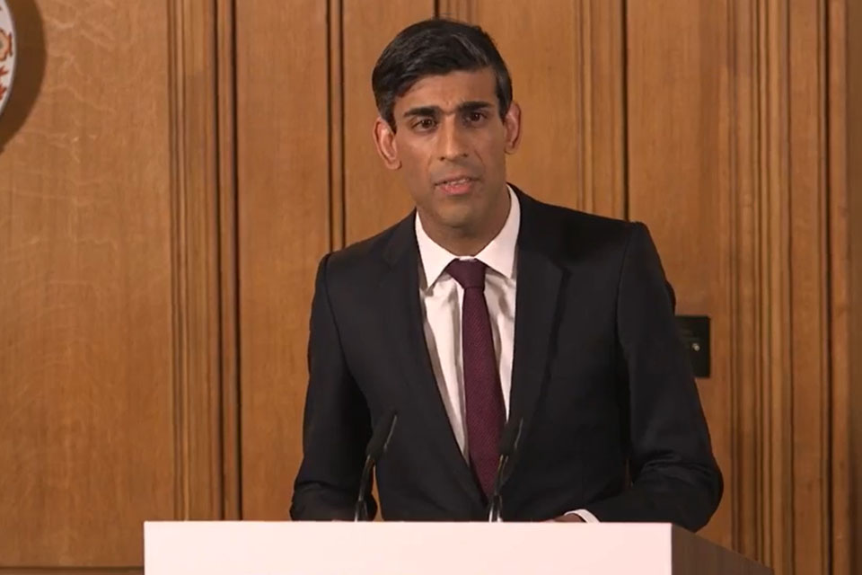 Chancellor Rishi Sunak delivering a coronavirus update at podium