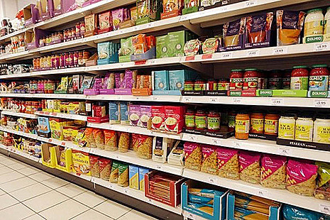 Supermarket shelves full of food