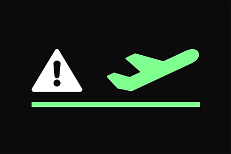 exclamation warning sign and an aeroplane