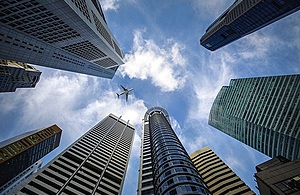 Plane flying over skyscrapers Singapore