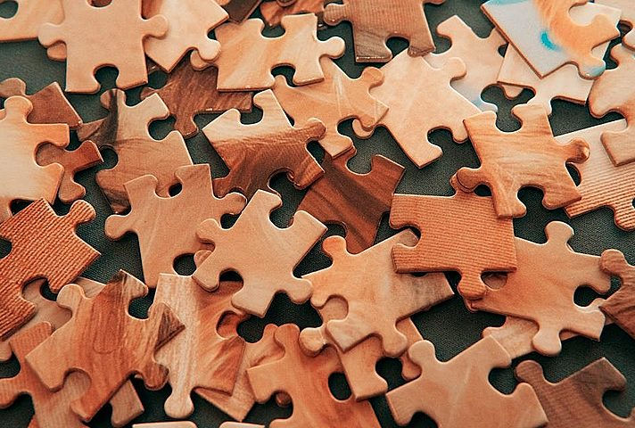 Brown jigsaw puzzle pieces