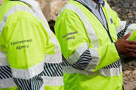 Two people wearing yellow EA jackets