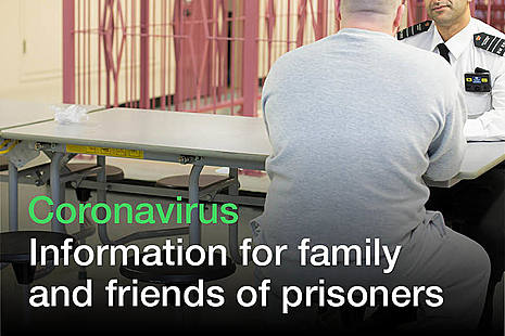 A prison officer talks with a prison resident